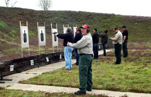 Deputy Sheriff Bob Beanblossom, rangemaster, gives instruction during the shooting portion of the Tipton Co. Handgun Permit class on March 30, 2013.